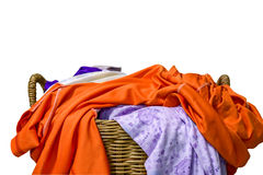 Many Clothes with in wicker basket on white background.  stock photos