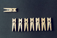 Many clothespin in a row on a black background Royalty Free Stock Images