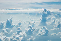 Many cloud in blue sky, view from the airplane Royalty Free Stock Image