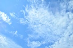 Many clouds in the bright blue sky. Royalty Free Stock Photography
