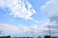 Many clouds in the bright blue sky. Royalty Free Stock Photo