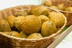 Many coconuts. On a basket Stock Photo