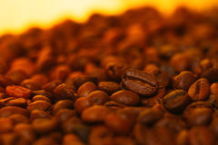 Many coffee beans in the blurred  background. Many coffee beans in the blurred   background Stock Photo