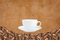 Many coffee beans and coffee cup Stock Image