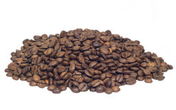 Many coffee beans isolated on white. Many coffee beans heap isolated on white Stock Photo