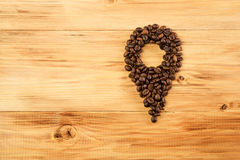 Many Coffee beans on wood background pin coffee. Coffee beans on wood background close-up. coffee pin Royalty Free Stock Image
