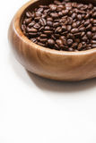 Many coffee beans in wooden bowl Stock Photo
