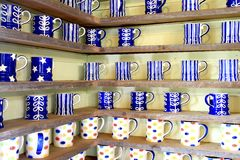 Many coffee cup on wood shelf background Royalty Free Stock Image
