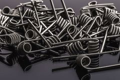 Many Coils for vape or e-cig dripping atomizers or RDA. Macro photo royalty free stock image