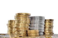 Many coin bank of yellow and white metal. Royalty Free Stock Images