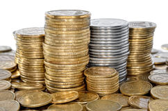 Many coin bank of yellow and white metal. Royalty Free Stock Image