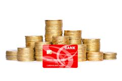 Many coins in column and bank credit card isolated on white Royalty Free Stock Image