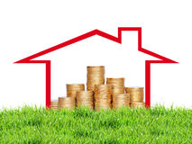 Many coins in column in house on green grass over white Stock Photo