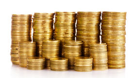 Many coins in column isolated Royalty Free Stock Photo