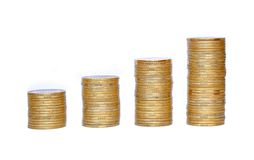 Many coins in column isolated on white Stock Photography