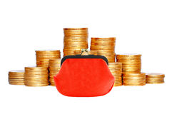 Many coins in column and red purse isolated on white Royalty Free Stock Image
