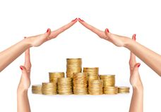 Many coins in columns and woman hands in house form isolated Stock Image