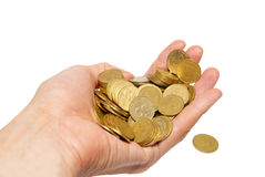 Many coins in cupped hand Stock Image