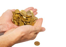 Many coins in cupped hands. Stock Photos