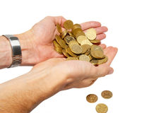 Many coins in cupped hands Royalty Free Stock Images