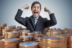 Many coins in front of a successful rich happy man stock photos