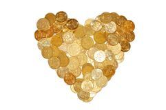 Many coins like heart symbol isolated on white Royalty Free Stock Photos