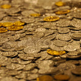 Many coins. Many sliver and gold coins spread Royalty Free Stock Photos