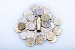 Many coins and tomb Royalty Free Stock Image