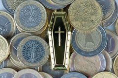 Many coins and tomb Stock Photography