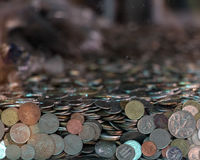 Many coins from various countries Royalty Free Stock Image