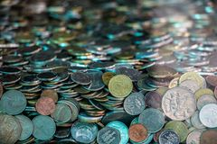 Many coins from various countries Stock Photos