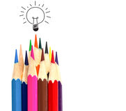 Many color pencil and light bulb on white, idea and teamwork Stock Image