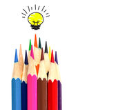 Many color pencil and light bulb on white, idea and teamwork Royalty Free Stock Images