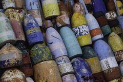 Many colored buoys. Many colored weathered wooden buoys stock photo