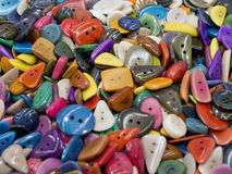 Many  colored buttons of various shapes  on each other Royalty Free Stock Photography