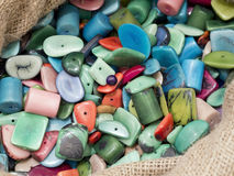 Many  colored buttons of various shapes  on each other Stock Photos