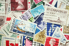 Many colored Canadian stamps Stock Image