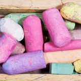 Many colored chalks in wooden box Royalty Free Stock Photo