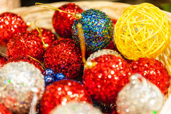 Many colored Christmas balls in a basket colorful xmas Background Stock Images