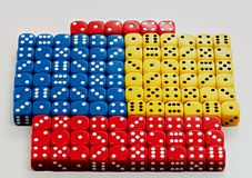 Many colored dice with random numbers being displayed. Collection of square dice with numbers and different colors Stock Photography