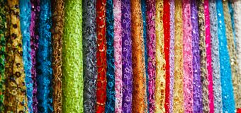 Many colored fabrics in the store Royalty Free Stock Photos