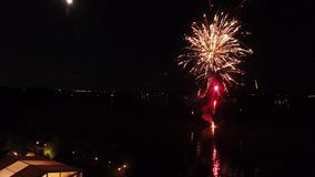 Fireworks from lake. Many colored fireworks in the night, dark sky stock video footage
