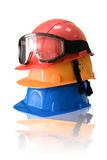 Many colored hardhats and goggles Royalty Free Stock Image