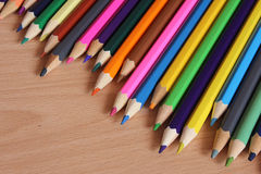 Pencils. Many colored hexagonal pencils lying on a table Royalty Free Stock Photos