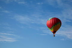 Many-colored hot air balloon with people fly Royalty Free Stock Image