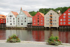 Many-colored houses on piles over the river Royalty Free Stock Photo