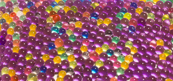 Many colored hydrogel beads Royalty Free Stock Image