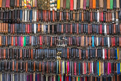 Many colored leather belts on a market Stock Photos