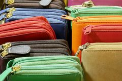 Colored leather wallets with zip on sale in leather goods. Many colored leather wallets with zip on sale in Italian leather goods Royalty Free Stock Photos