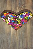 Many Colored Letters In The Wooden Heart Shape Royalty Free Stock Photos